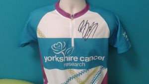 The Yorkshire Cancer Research cycling top signed by Sir Bradley Wiggins